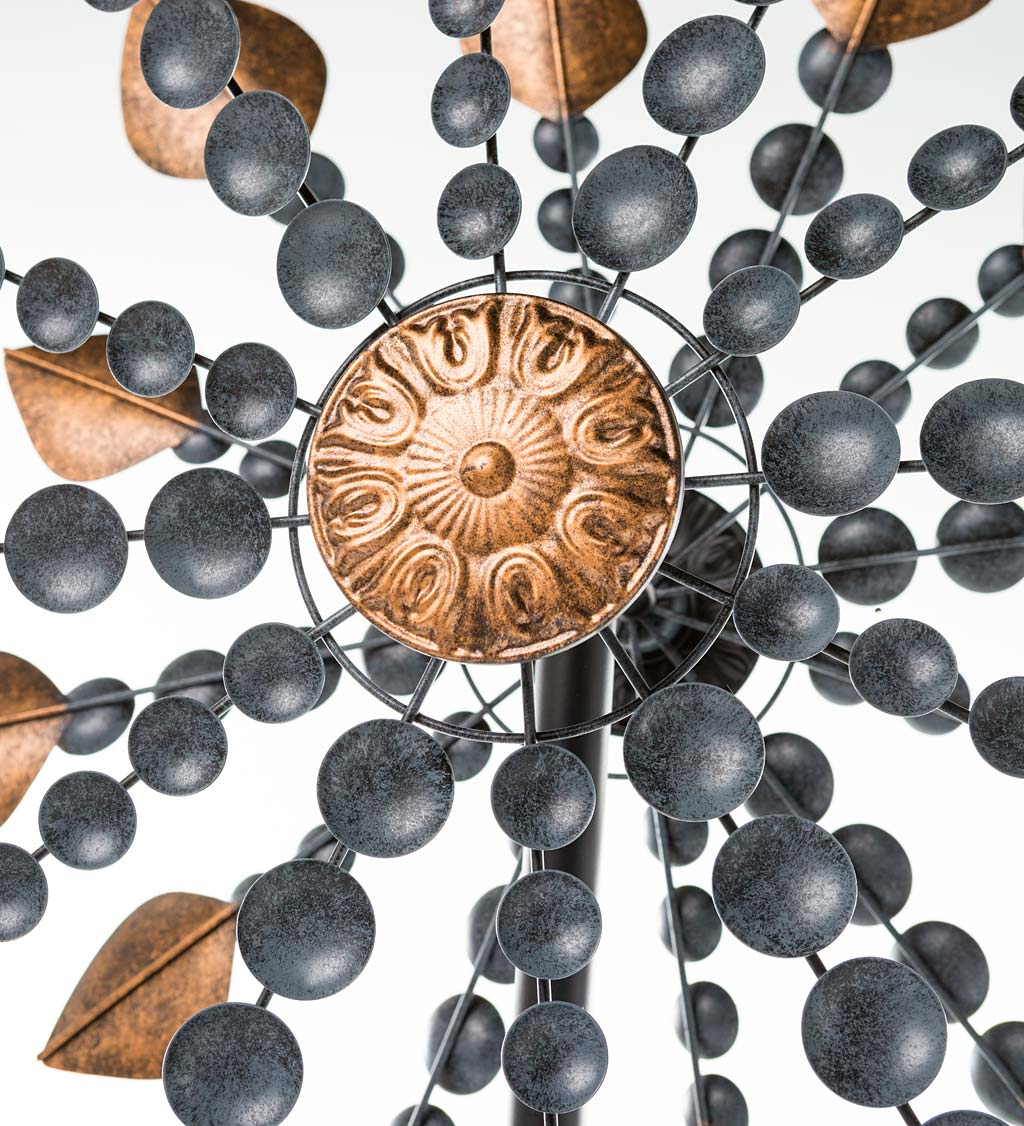 Weathered Gray and Bronze-Colored Metal Cups and Leaves Wind Spinner