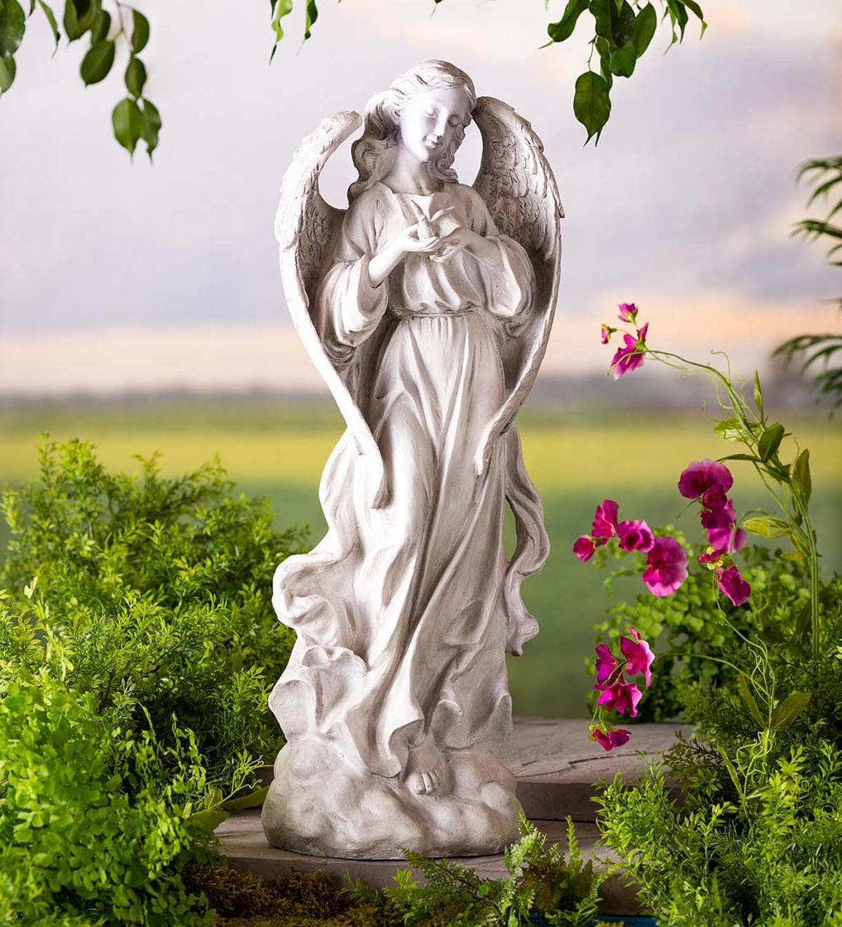 Tall Angel Statue With Bird Statue Wind And Weather