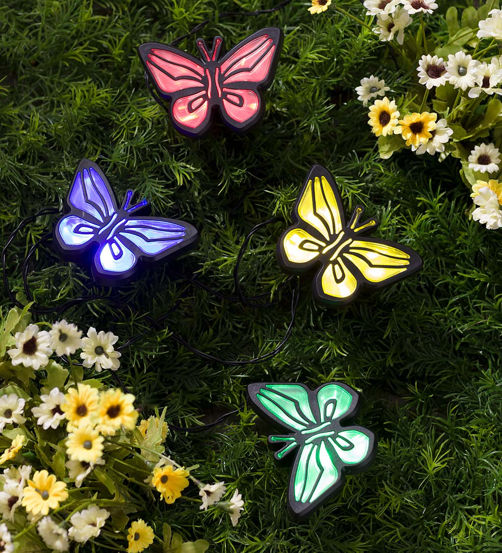 String of Four Solar Lighted Butterfly Garden Stakes with Solar Panel Stake