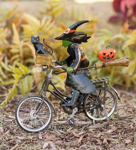 Metal Witch on a Bicycle