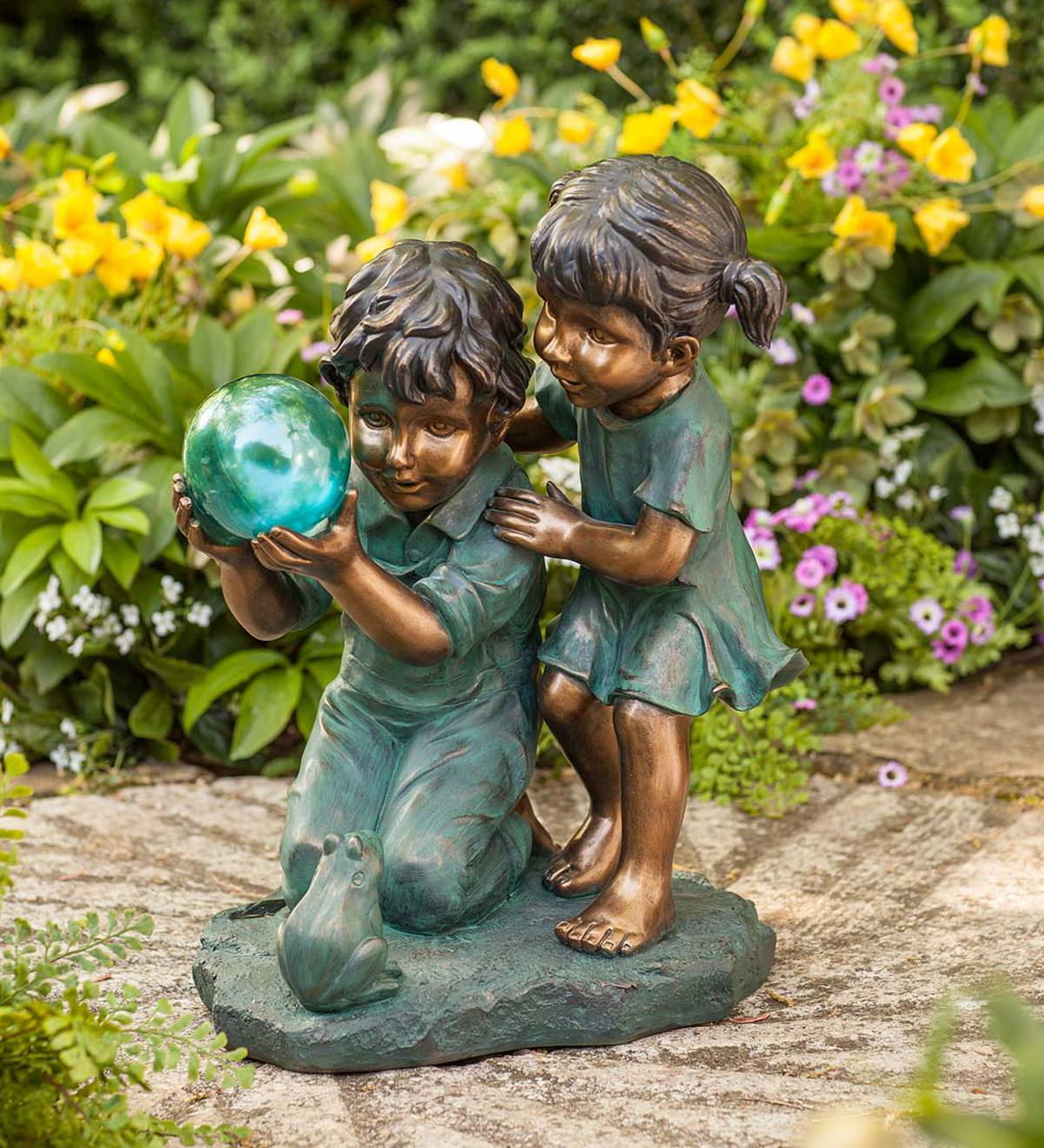 Children with Solar Ball Sculpture