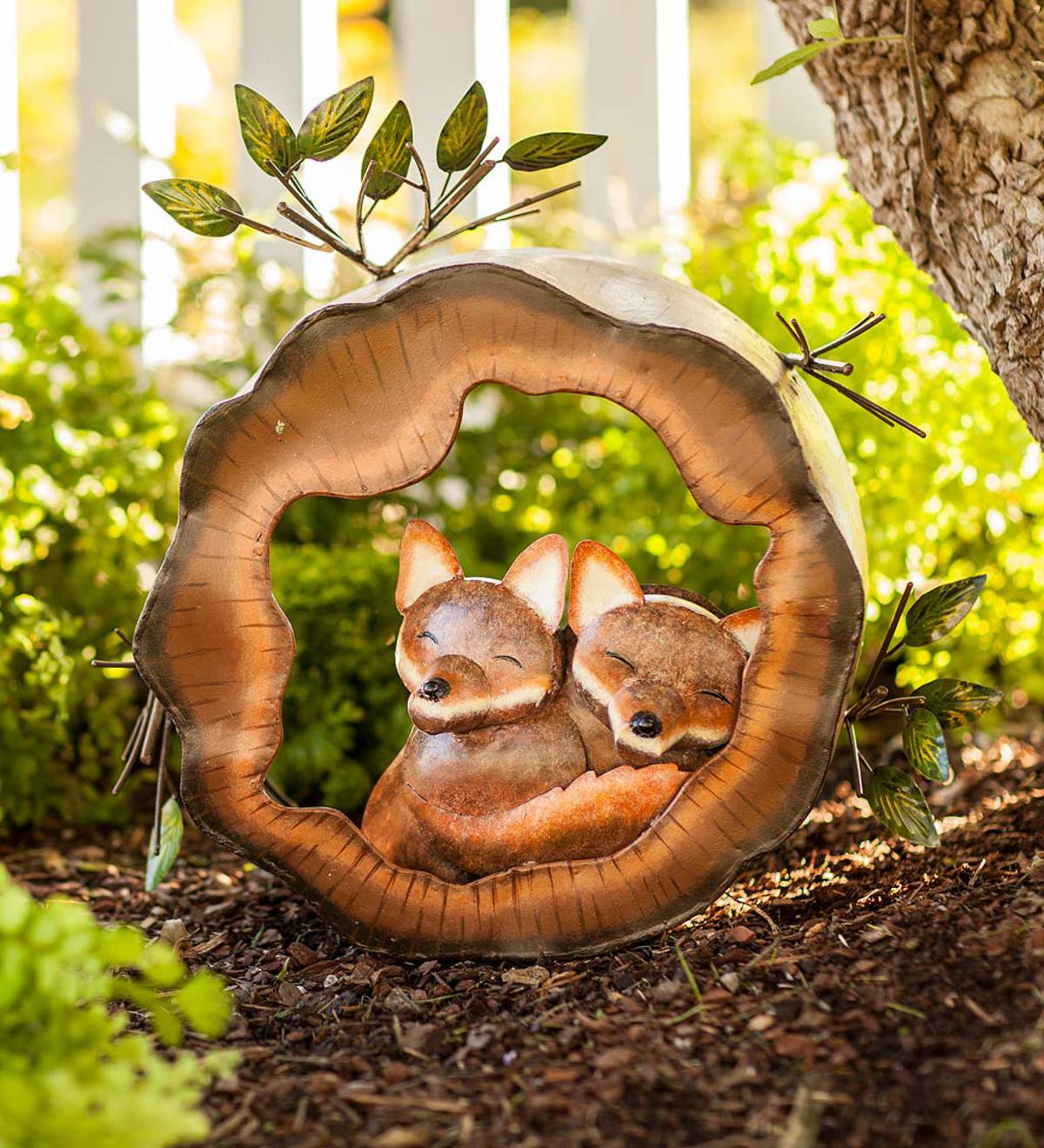 Foxes in a Log Metal Sculpture