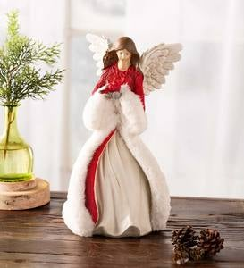 Holiday Angel In Long Faux-Fur Trimmed Coat Holding Cardinal