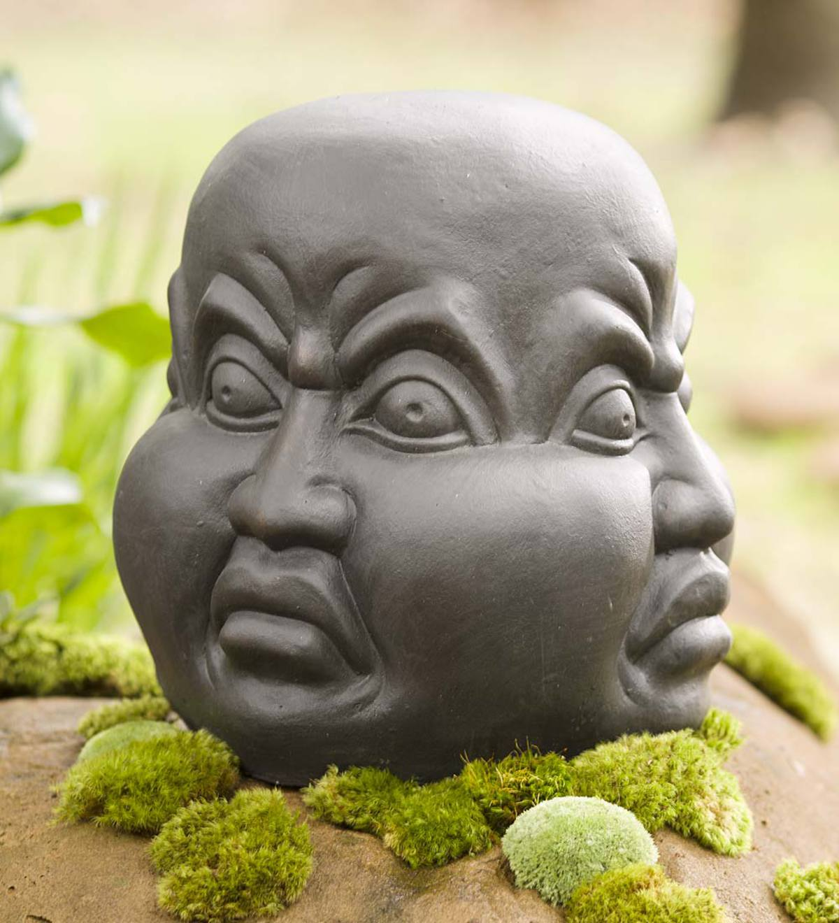 Four-Sided Angry Head Sculpture