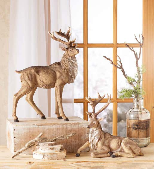 Image of two lifelike tabletop elk statues. Shop Tabletop Décor