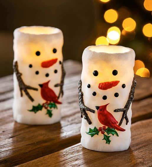 Image of whimsical Snowman candles. Shop Holiday Lighting