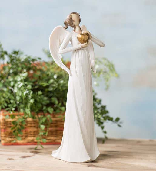 Image of angel tabletop figurine with a gold heart. Shop Gifts for Her