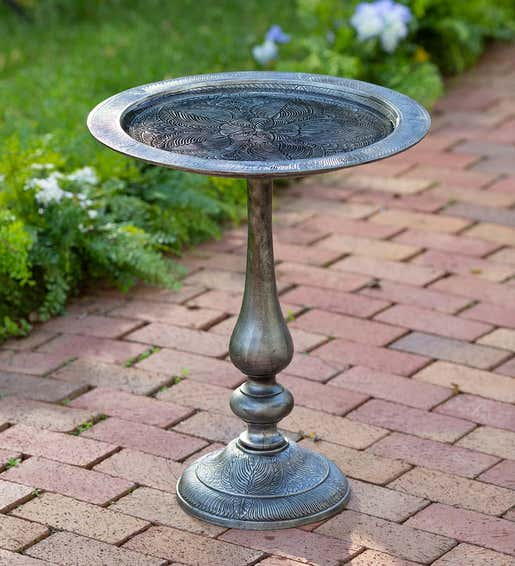 Image of elegant aluminum birdbath with etched floral design. Shop Gifts For Bird Lovers