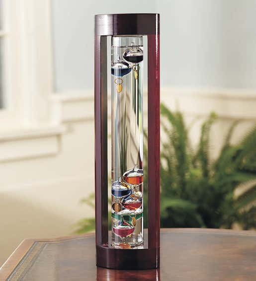 Image of a Galileo thermometer in a cherry wood frame. Shop Gifts for Him