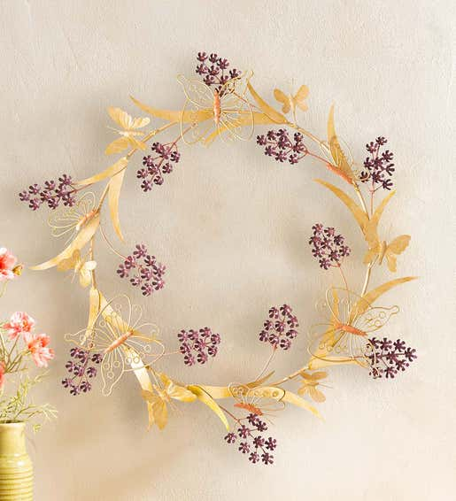 Image of gold metal holiday butterfly wreath with purple flowers. Shop Holiday Wreaths & Garlands